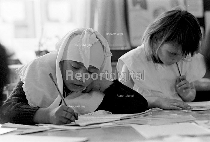 Muslim pupil studying maths lesson Junior and infant school Dewsbury Yorkshire - John Harris - 1989-05-09