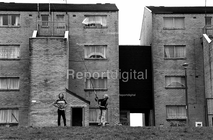 Children playing practising casting with a fishing rod, High View, Billybanks council housing estate Penarth South Wales an area of poor housing and multipul deprivation - John Harris - 1989-08-18