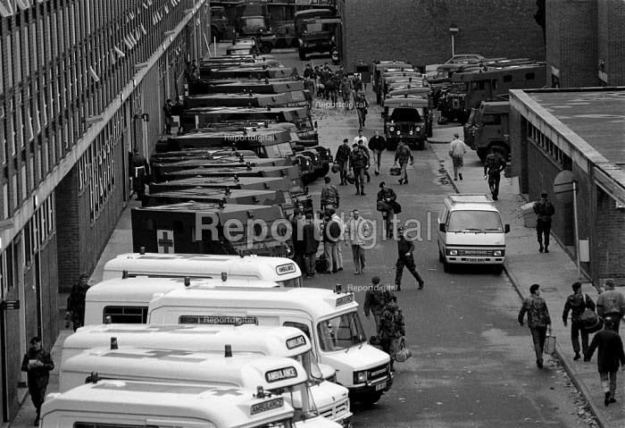 Army unit preparing Military Ambulances to replace NHS accident and emergency Ambulance crew suspended for working to rule. Chelsea Barracks - John Harris - 1989-11-08