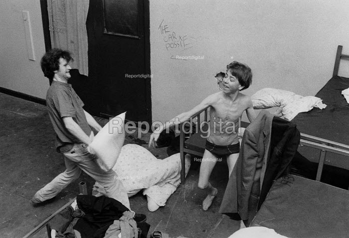 Homeless youth having fun, a pillow fight at The Boot night shelter Birmingham 1991, for young men up to 16yrs. They spend their days on the street - John Harris - 1991-05-19
