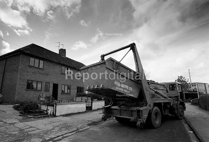 Lorry removing a skip Local Authority housing being refurbished Bristol - John Harris - 1991-10-24