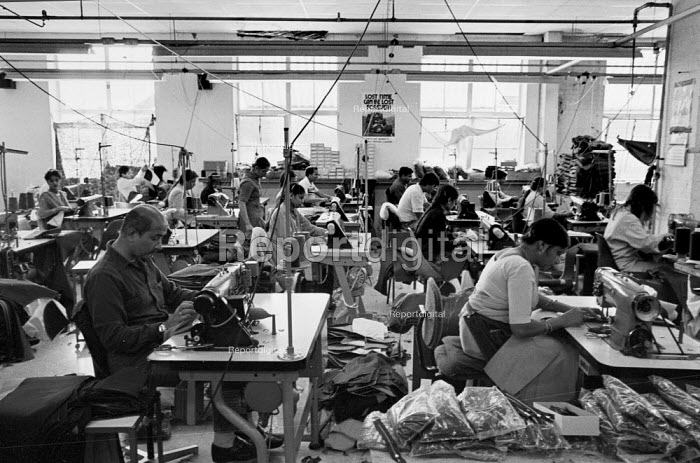 Asian men and women working in a Leicester sweatshop producing textiles. The workers have low pay and poor conditions - John Harris - 1993-04-21