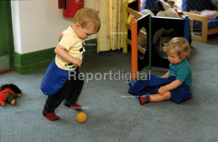 Toddlers playing at a nursery which cares for office workers' babies and young children - John Harris - 1993-06-04