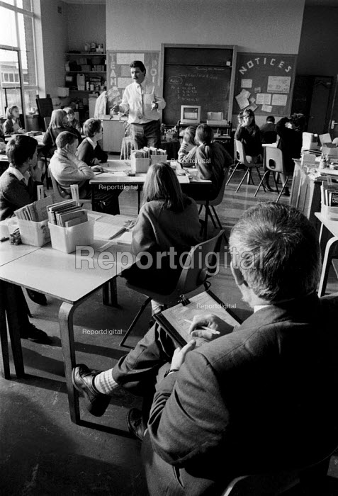 OFSTED - Office For Standards in Education inspector inspecting class teaching at a midlands Junior school. - John Harris - 1993-11-18