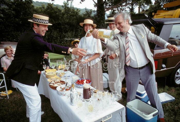 Wealthy picnickers enjoying strawberries and cream, champaign, Henley Royal Regatta Henley on Thames 1993 - John Harris - 1993-07-10