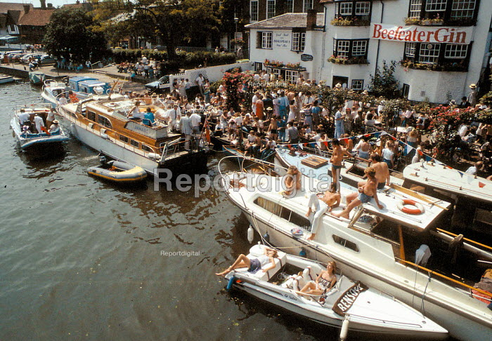 Wealthy relaxing in the sun outside a pub at Henley Royal Regatta Henley on Thames - John Harris - 1993-07-10