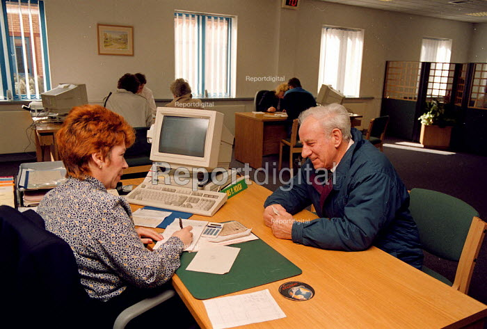Interviewing a member of the public with a Tax enquiry Inland Revenue office Dudley - John Harris - 1994-04-13