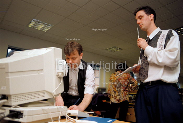 Working on a computer problem Inland Revenue office, Dudley - John Harris - 1994-04-13
