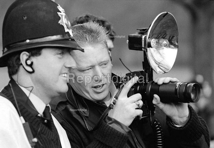 Police photographing protesters against the Criminal Justice Act outside Chequers - John Harris - 1994-12-11