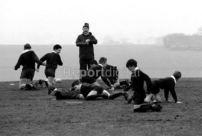Boys being coached in rugby at a Comprehensive school. - John Harris - 1994-01-09