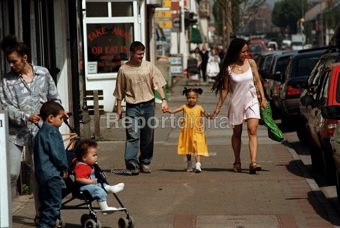 Parents and children shopping in the high street Bute Town Cardiff South Wales area of multipul deprivation - John Harris - 1995-05-04