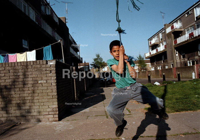 Children playing Local Authority housing estate Bute Town Cardiff South Wales area of multipul deprivation - John Harris - 1995-05-04