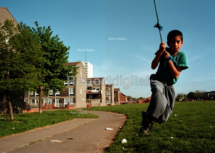 Child playing on council estate Bute Town Cardiff South Wales 4/5/95 - John Harris - 1995-05-04