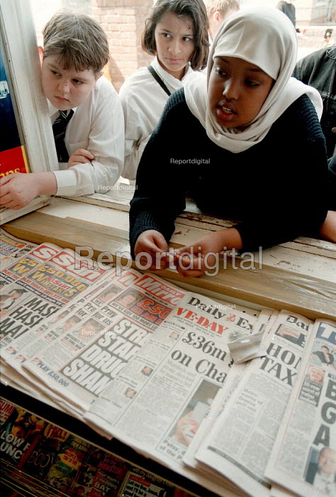 School pupils waiting to be served at a hatch at a corner shop and newsagent Bute Town Cardiff South Wales - John Harris - 1995-05-04