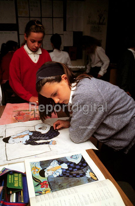 Pupil painting a copy from an art book during an art lesson. Secondary School ... - John Harris - 1995-04-09