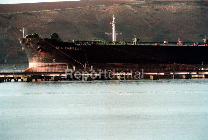 Sea Empress oil carrier moored after spilling up to 100,000 tons of it's oil cargo as it approached Milford Havern port - John Harris - 1996-02-22