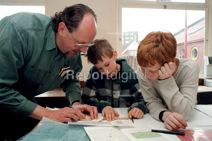 Teacher teaching maths at a Combined Junior and Infant school in the Midlands - John Harris - 1996-06-20