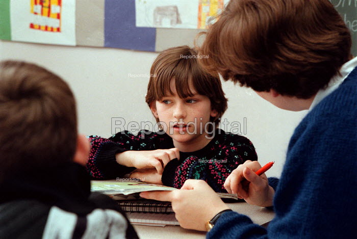 Teacher and pupils in discussion at a Combined Junior and Infant school in the Midlands - John Harris - 1996-05-20