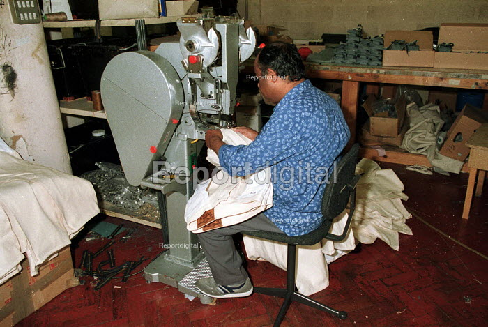 Sewing jeans together at a sweatshop in old factory Leicester - John Harris - 1996-08-16