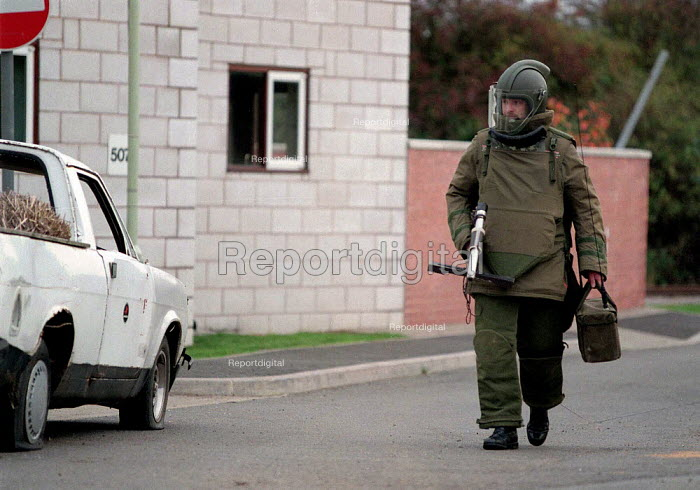 Army bomb disposal squad training with protective clothing for finding and defusing explosive devices and associated booby traps often in Northern Ireland - approaching a suspect package - John Harris - 1996-10-09