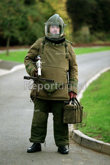 Army bomb disposal squad training with protective clothing for finding and defusing explosive devices and associated booby traps often in Northern Ireland - John Harris - 1996-10-09