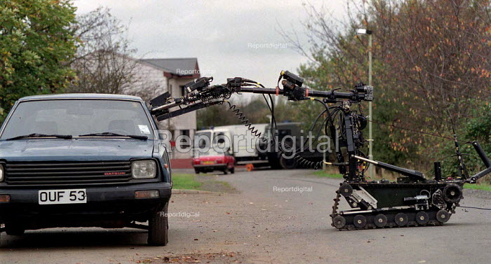 Army bomb disposal squad training with protective clothing for finding and defusing explosive devices and associated booby traps often in Northern Ireland robot in use - John Harris - 1996-10-09