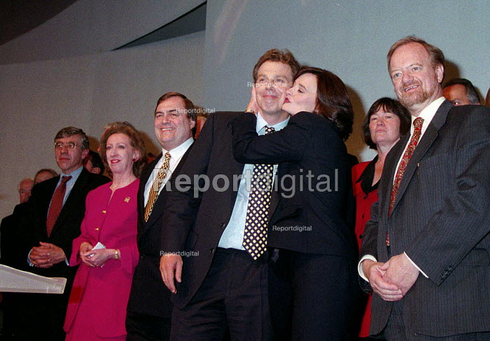 Cherie Blair kissing Tony Blair surrounded by shadow cabinet Labour Party conference 1996 - John Harris - 1996-10-01
