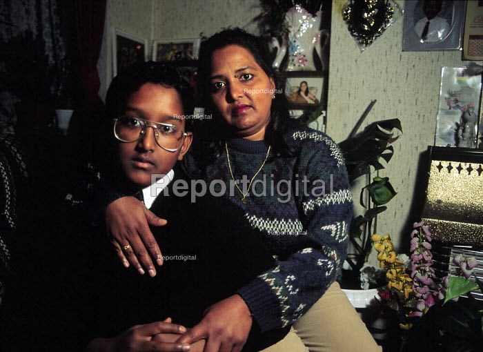 Prakash and Prem at home, a Mother and son facing deportation under immigration law after fleeing a violent husband. Supported by Unison her trades union. Many argue that the laws are inherently racist