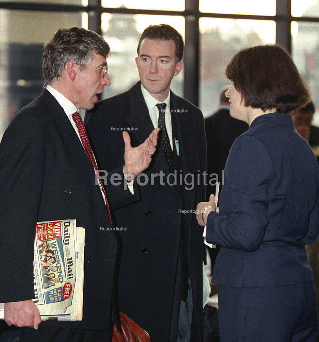 Jack Straw MP holding Daily Mail newspaper Peter Mandelson MP and Joe Moore Labour chief press officer consulting on spin at Labour Local Government Conference Nottingham - John Harris - 1997-02-08