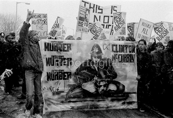 Protest at the death of Clinton McCurbin, Telford 1997, a black youth who died whilst in police custody. There was wide spread anger in the black community at his death of asphyxia whilst being arrested by two police officers. Banners carried on the demonstration accused the police of racism and depicted the death as a racist murder - John Harris - 1997-07-02