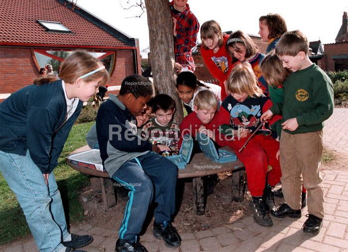 Pupils playing battleships game in playground. Milverton Junior School Leamington Spa 21.3.97 - John Harris - 1997-03-21