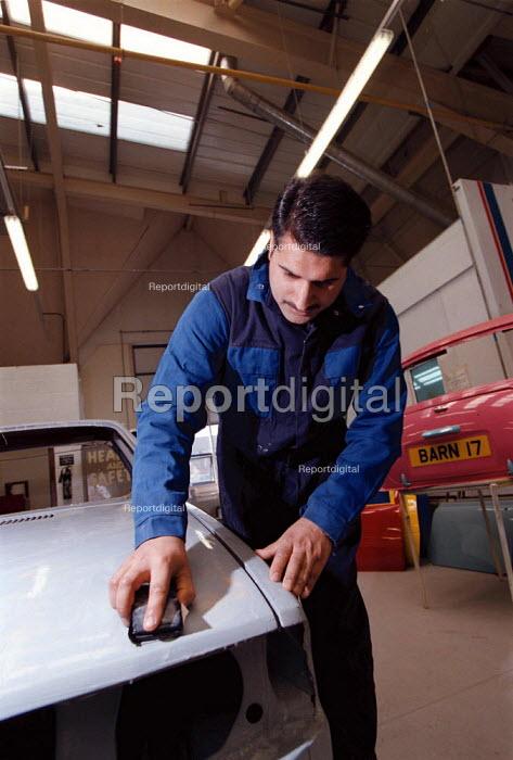 Adult NVQ student training to repair car bodywork vehicle maintenance Further Education College - John Harris - 1997-04-10
