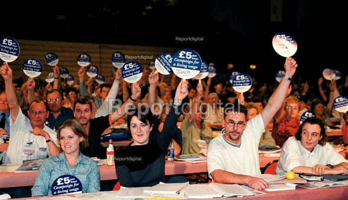 Unison delegates voting with �5.00 per hour Campaign for a living wage placards for a minimum wage TUC Conference 1999 - John Harris - 1999-09-15