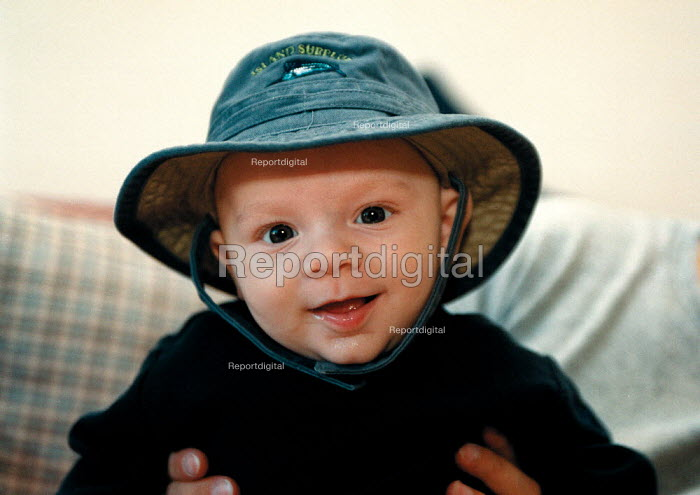 Baby boy at 15 weeks wearing a hat - John Harris - 1999-09-30
