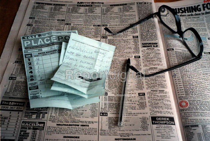 Newspaper horse racing pages, betting slips, spectacles and pen on lounge table at home - John Harris - 1999-09-03