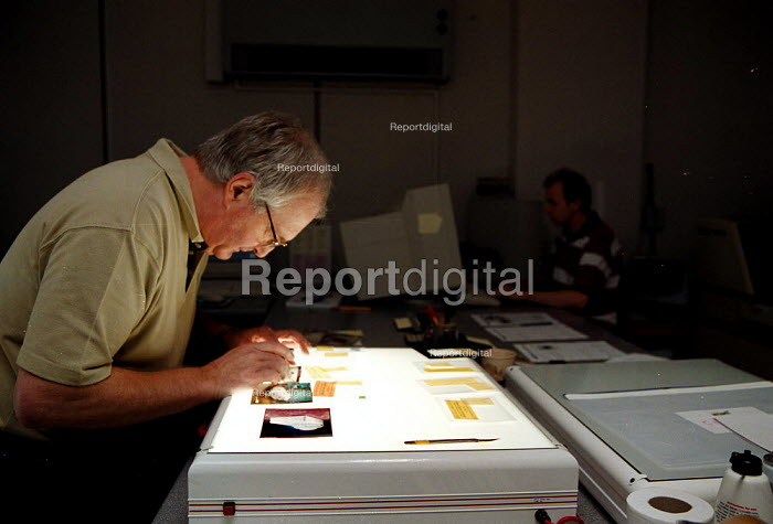 Printer handling color transparencies on a light box prior to scanning on a drum scanner for a digital press at a printing company - John Harris - 1999-09-08