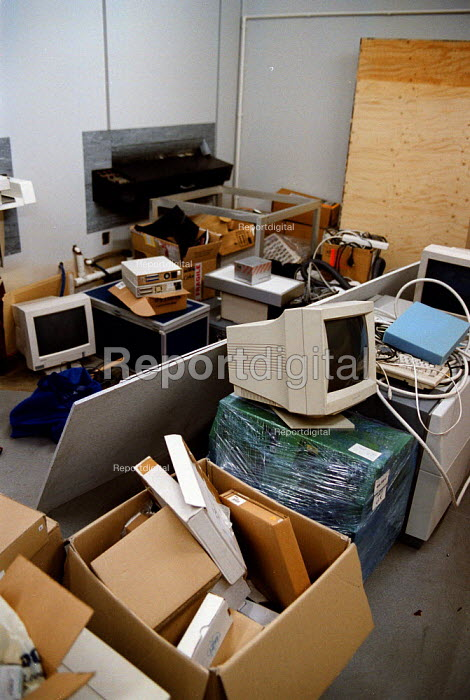 Old technology, redundant computer and printing equipment stored in an old darkroom at a printing company now using the latest digital press. - John Harris - 1999-09-08