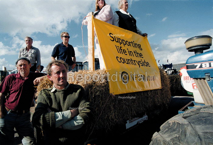 """Farmers and their families listening, NFU protest meeting """"Keep Britain Farming"""" Stratford on Avon Cattle Market, at the condition of agricultural industry and farming, the low prices obtained for their produce, the resulting decline in the rural community and life in the countryside. - John Harris - 1999-09-21"""