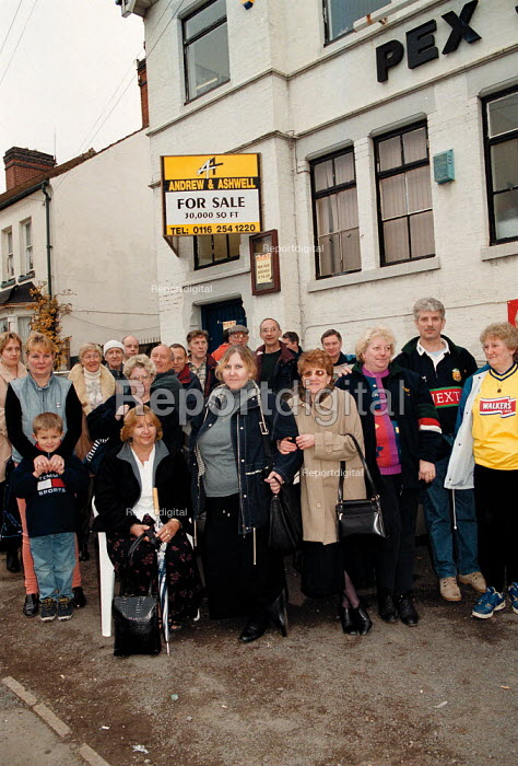 Sacked textile workers blockading their factory after bosses sacked the entire work force, leaving thousands of pounds in wages unpaid. Pex Sock Manufacturers, Earl Shilton Leicestershire - John Harris - 1999-10-29