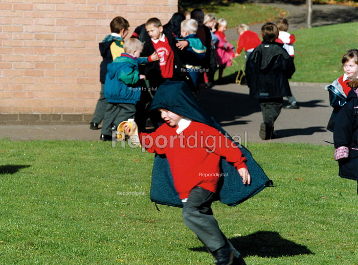 Pupil running with a banana at break time. Playground Primary School - John Harris - 1999-10-18