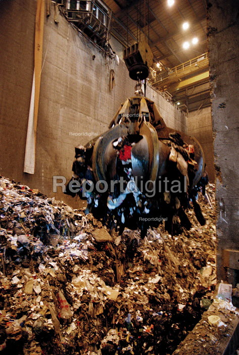 A huge grab moving waste and rubbish to furnaces which incinerate combustible materials and extracts the noncombustible or toxic materials for recycling or disposal. The heat is used to generates electricity at the power station using steam turbines. - John Harris - 1999-10-15