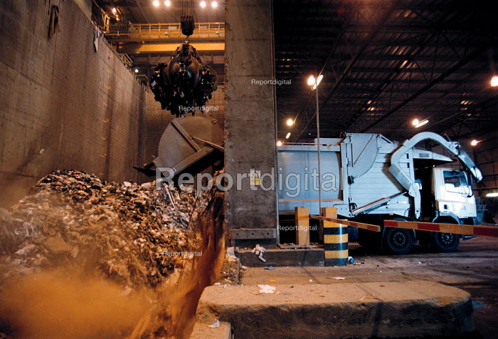 Refuse lorry delivering waste and rubbish to furnaces which incinerate combustible materials and extracts the noncombustible or toxic materials for recycling or disposal. The heat is used to generates electricity at the power station using steam turbines. - John Harris - 1999-10-15