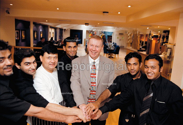 John Jordan TGWU Organiser with waiters cook and staff at Smimia Pinks Indian Restaurant Birmingham where the majority of the workforce have joined the TGWU trades union - they have yet to get company recognition - John Harris - 1999-10-08
