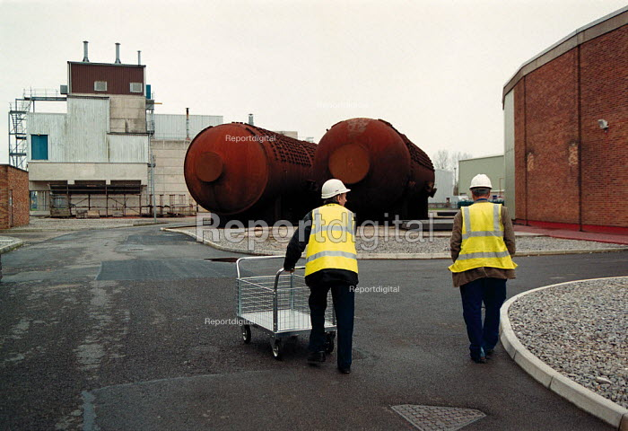 Contractors on site Berkley BNFL Nuclear power station on the severn estuary. The first Magnox reactor it is now slowly being decommissioned. The boilers are now laid on their sides - John Harris - 1999-11-30
