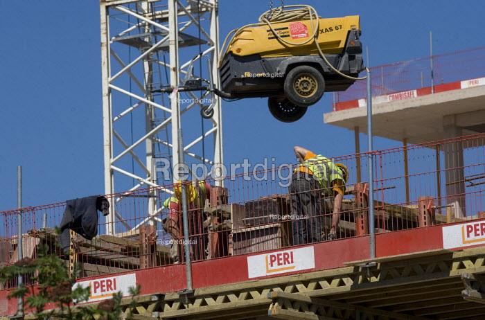 Moving a power generator using a crane on a building site, Coventry. - John Harris - 2011-05-25