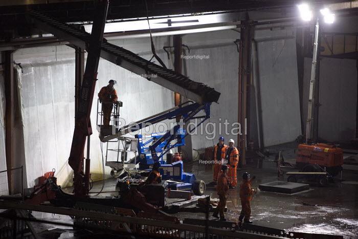 Construction workers demolishing part of a building at night. Birmingham City centre - John Harris - 2011-11-12