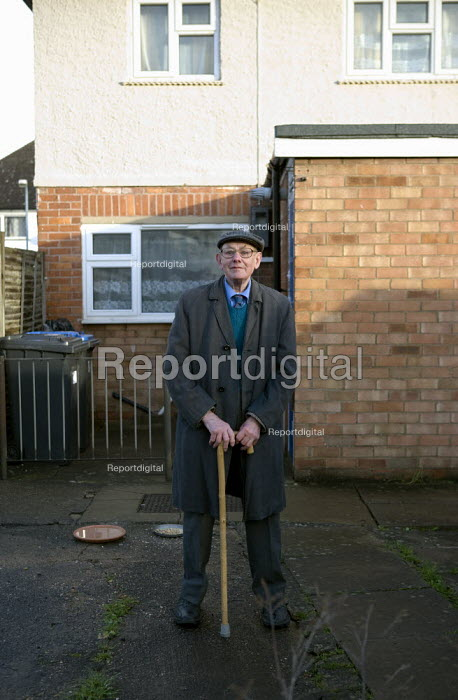 Pensioner outside his Housing Association home where he lives alone, Stratford upon Avon, Warwickshire. - John Harris - 2012-01-19