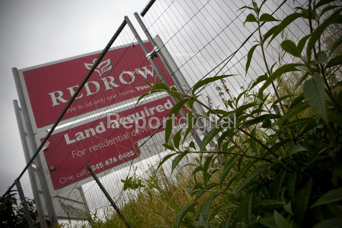 A brownfield site acquired for residential housing development by Redrow (UK's sixth-biggest housebuilder by turnover) the site has been empty since 2007 due to the credit crunch and subsequent recession. Stratford-upon-Avon, Warwickshire. - John Harris - 2012-09-20