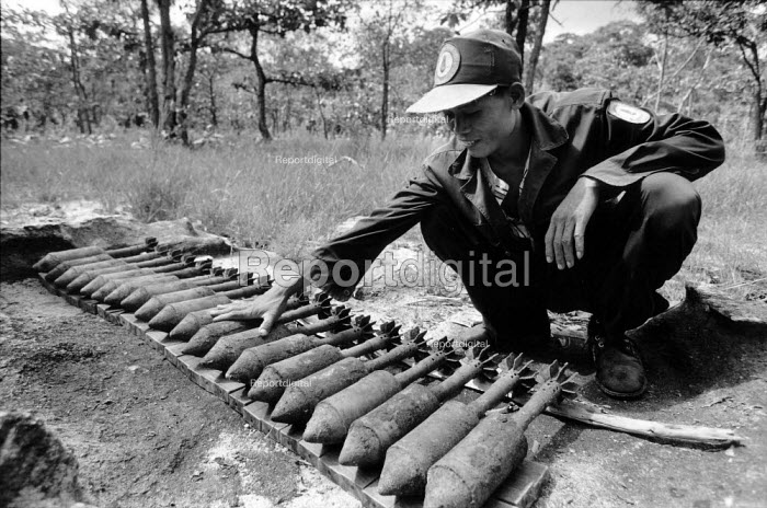 Vietnamese unexploded ordnance from the 1960s collected from a forest in southern Laos 1998 - Jim Holmes - 1998-07-03