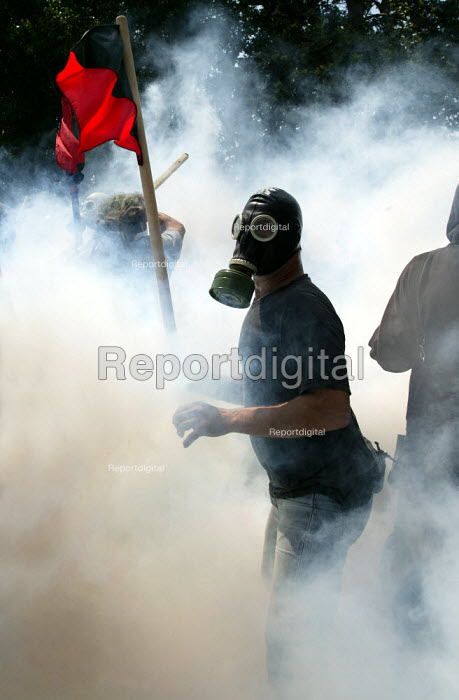 Riot police fire teargas and attack protesters during clashes inside the Red Zone security cordon surrounding the European Union Summit in Halkidiki, Greece. - Jess Hurd - 2003-06-20